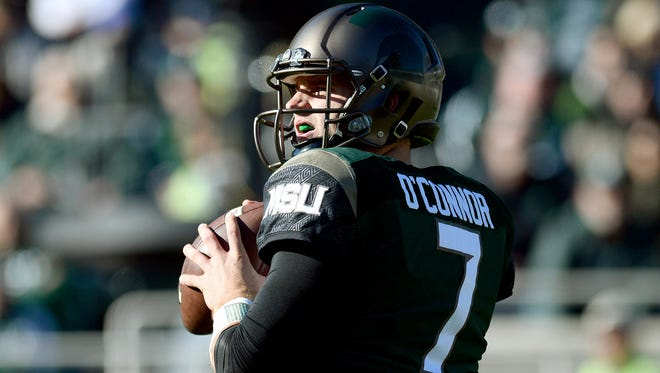 Michigan State University  senior quarterback Tyler O'Connor (7) looks downfield for an open receiver during the first half of the MSU vs. Rutgers Big Ten football game at  Spartan Stadium Saturday, Nov. 12, 2016 in East Lansing.