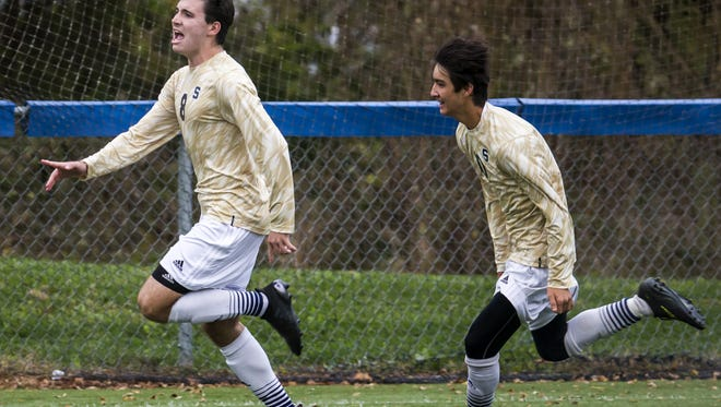 Salesianum's Jason Blackwell (left) celebrates after scoring on a penalty kick in overtime period to give the Sals a 3-2 win over Indian River on Nov. 1.