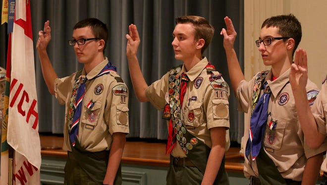 Nathan Potter, left, Aaron Wheat and Brennan Vandehey say the Eagle Scout oath during the induction ceremony for the 2016 Eagles at the Annual House of Eagles Banquet Monday, Jan. 9, 2017, in the First Christian Church fellowship hall. 23 young men received their Eagle Scout Award at the banquet.