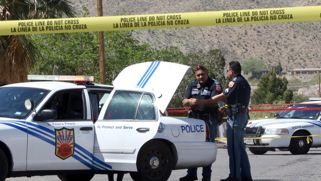 Police officers investigate a stabbing on Kemp Avenue near the intersection with Dyer Street on Wednesday in Northeast El Paso.