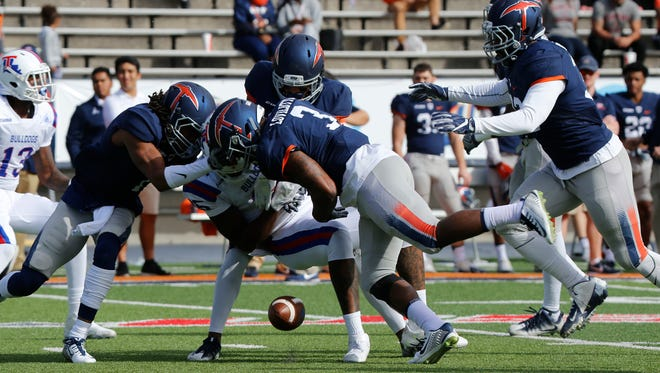 Dante Lovilotte forces a fumble after the pas completion as La Tech's Kam McNight has the ball stripped. by members of the UTEP defense. La Tech would go on to hand the Miners their 11 straight loss of the season by a score of 42-21.