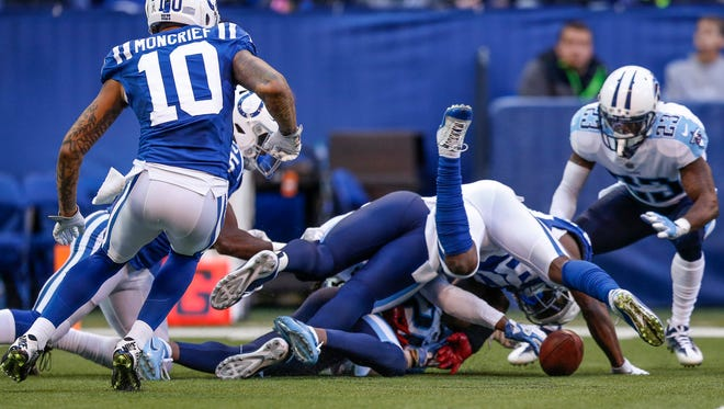 Indianapolis Colts running back Marlon Mack (25) fumbles and the Tennessee Titans recover at Lucas Oil Stadium in Indianapolis on Sunday, Nov. 26, 2017.