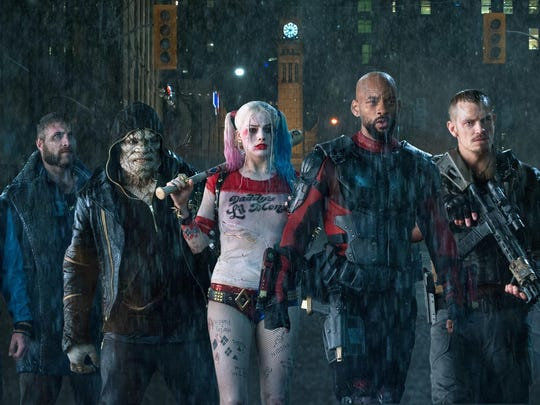 "Jay Hernandez, from left, Jai Courtney, Adewale Akinnuoye-Agbaje, Margot Robbie, Will Smith, Joel Kinnaman and Karen Fukuhara star in ""Suicide Squad."""