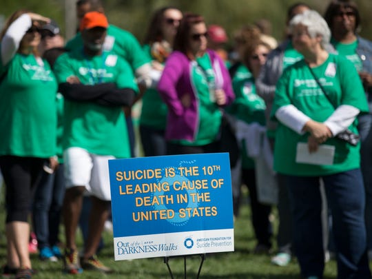 This fact about suicide was displayed at a sign at the Out of the Darkness walk at White River State Park, a fundraiser on Saturday, Sept. 13, 2014, for the American Foundation for Suicide Prevention.
