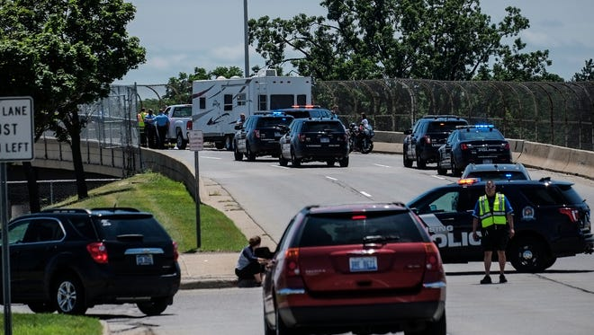 Lansing Police and Fire Departments are at the scene of a motorcycle accident on the southbound Martin Luther King Jr. Blvd. bridge Monday, July 3, 2017.