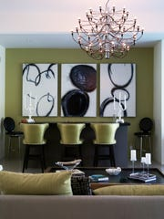Interior Designer Christopher Kennedy incorporated the original bar into the living room design.