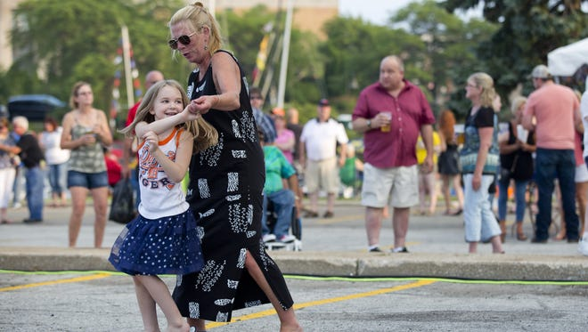 Tammy O'Donnell dances with her niece, Lillian McCullough, 6, of Port Huron on Friday. Tammy O'Donnell dances with her niece Lillian McCullough, 6, of Port Huron, during Boat Night Friday, July 17, 2015 on the Black River in Port Huron.