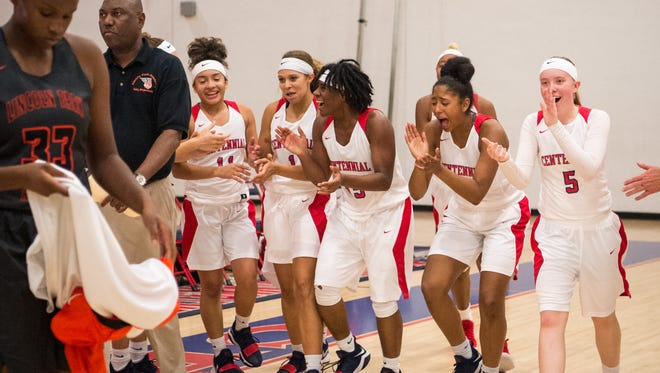 The jubilant St. Lucie West Centennial team celebrates after their dramatic come-from-behind victory over Lincoln Park Academy during the high school girls basketball game Monday, Dec. 18, 2017, at St. Lucie West Centennial High School in Port St. Lucie.