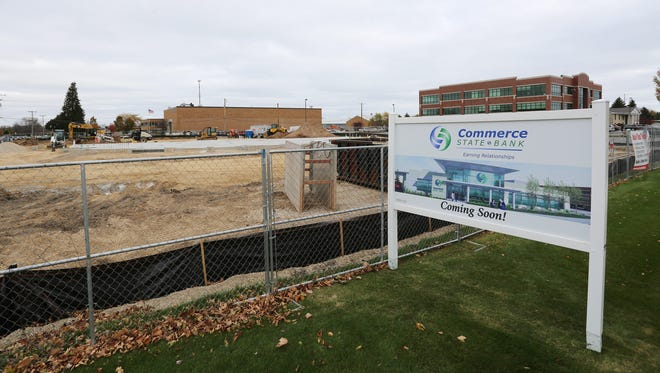 A sign near the construction along Kohler Memorial Drive and N. 23rd street shows what the Commerce State Bank building will look like when completed.