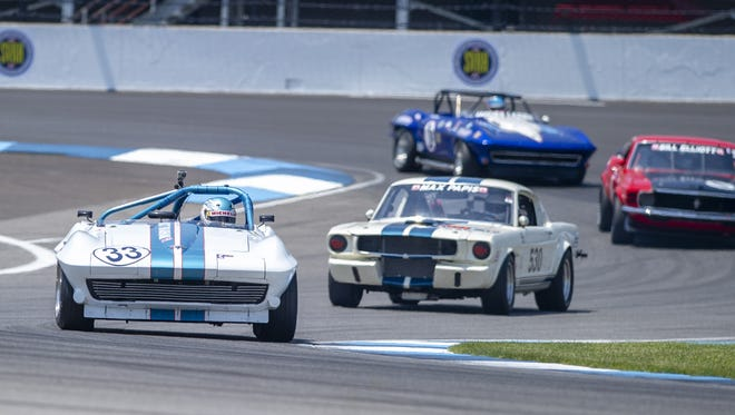 The 1963 Corvette driven by Matthew Brabham and amateur Mike Donohue (33), leads the pack through the second turn on the course during the Indy Legends Charity Pro-Am race, Saturday, June 16, 2018, at the Indianapolis Motor Speedway. The event is part of the Brickyard Vintage Racing Invitational weekend at the track organized by the Sportscar Vintage Racing Association.