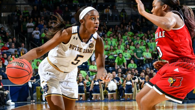 Notre Dame Fighting Irish guard Jackie Young (5) dribbles as Louisville Cardinals guard Asia Durr (25) defends in the second half at the Purcell Pavilion.