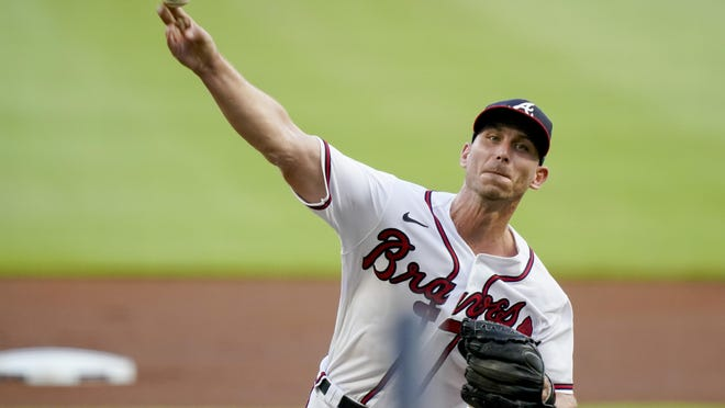 Atlanta pitcher Josh Tomlin delivers in the first inning against the Washington Nationals on Tuesday, Aug. 18, 2020, in Atlanta.