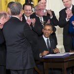 President Barack Obama signs trade and worker assistance bills on June 29. Congress returns Tuesday hoping to reach agreement on issues such as renewing highway funding and avoiding a government shutdown.