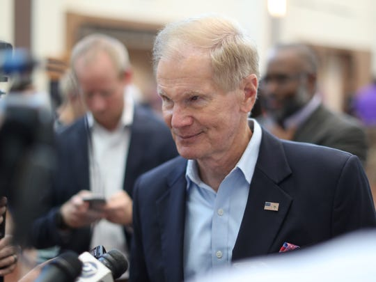 "Senator Bill Nelson on hand during a ceremony at the U.S. Department of Veterans Affairs Health Care Center in Tallahassee as it's renamed in honor of Marine Corps Sgt. Ernest ""Boots"" Thomas on Tuesday, Aug. 7, 2018."