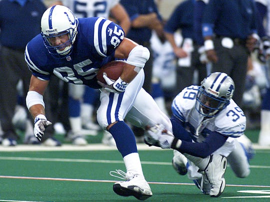 Lions defensive back Lamar Campbell tries to bring down Colts tight end Ken Dilger in an October 2000 game at the RCA Dome.