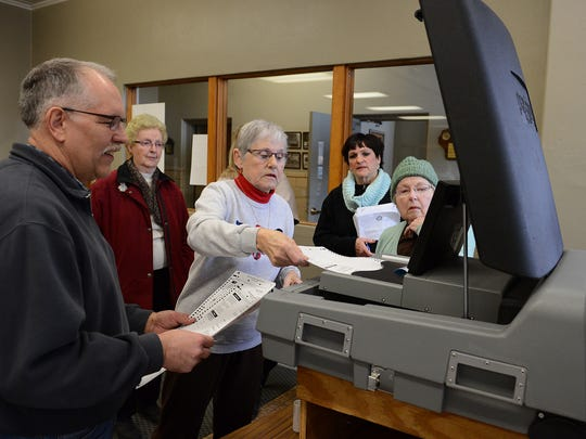 Election officials test voting machines in 2015 for the city of Green Bay before Tuesday's primary balloting.
