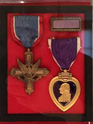 The Distinguished Service Cross and Purple Heart belonging to Greeley. B Williams, the first Johnson County resident killed in World War II, are now kept at St. Patrick Catholic Church in Iowa City.