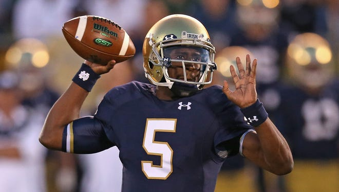 New Florida State quarterback Everett Golson, seen playing for Notre Dame last season, will compete with Sean Maguire to be the Seminoles starter.