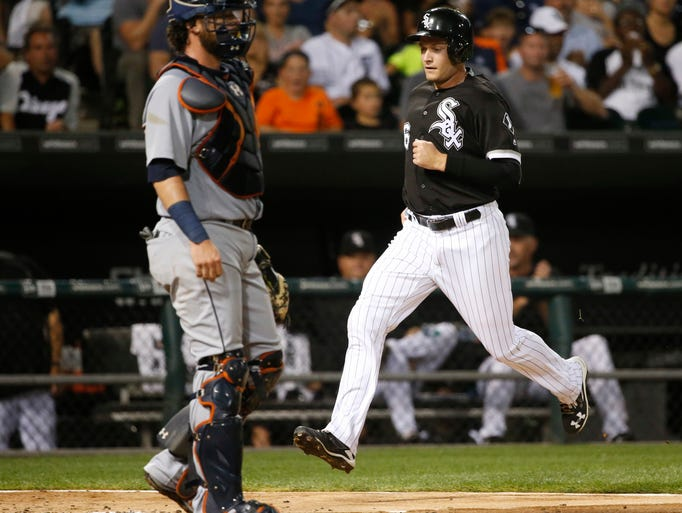 Chicago White Sox's Jason Coats scores past Detroit