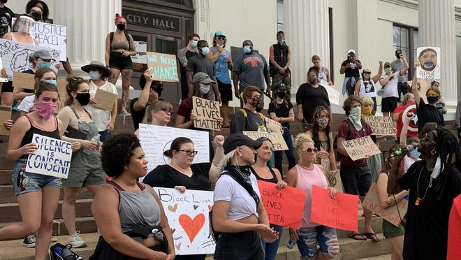 Activist Tim Joyner, seen here addressing a crowd protesting police brutality Saturday at Wilmington City Hall in June, helped de-escalate a confrontation between police and protesters in Wilmington on Tuesday, July 14.