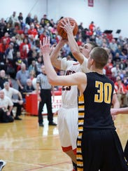 Buckeye Central's Tyler Trapp attempts to score against