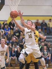 Colonel Crawford's Gavin Feichtner lays it in against