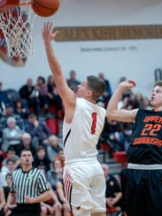 Bucyrus' Gram Dick attempts a basket early in the game.