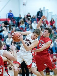 Buckeye Central guard Max Loy snags a rebound.