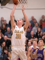 Colonel Crawford's Harley Shaum goes for layup.