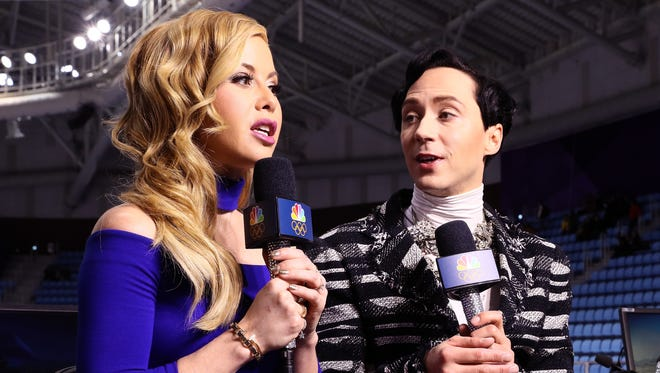 Figure skating analysts Tara Lipinski and Johnny Weir prepare for the start of the pair skating short program on day five of the PyeongChang 2018 Winter Olympics at Gangneung Ice Arena on Feb. 14.