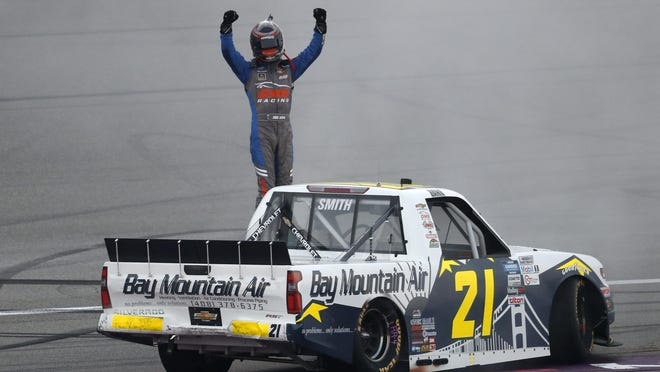 GMS Racing driver Zane Smith celebrates after winning the NASCAR Truck Series' Henry Ford Health System 200 at Michigan International Speedway Friday night.