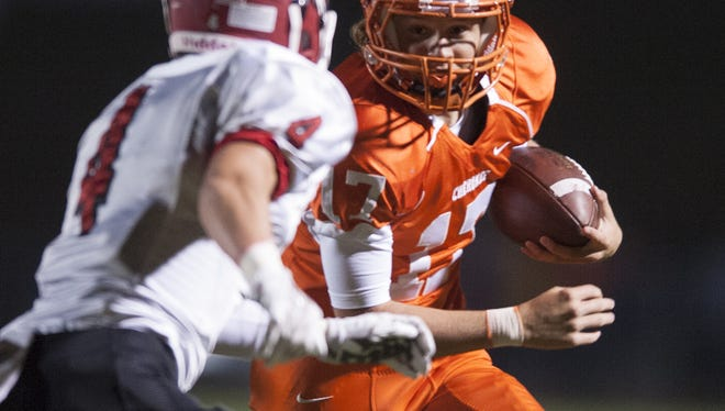 Cherokee quarterback Jacob Bodine eyes up Lenape defender Tim Montgomery during the first half of Friday's West Jersey Football League game. No. 3 Cherokee won 21-7.