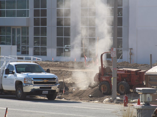 Natural gas spews from a ruptured line Thursday afternoon in the 2400 block of Conejo Spectrum Street in Thousand Oaks.