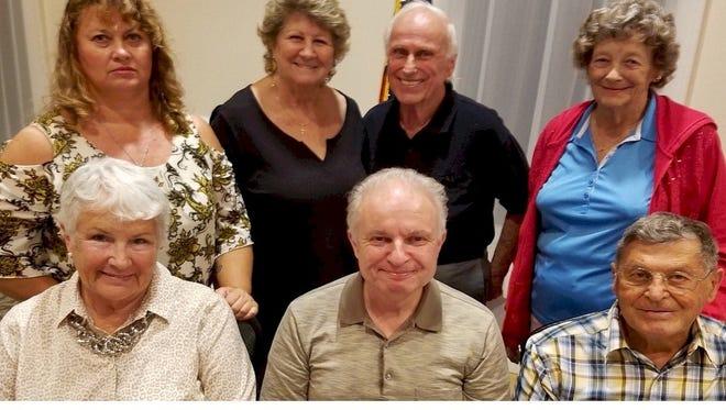 Sandpiper Bay Homeowner's Association (Sandpiper Bay Community) 2018 Board of Directors, top row, from left, Kelly Lee, director; Carol Taht, director; Don Harris, director; Ann Hanson, director; bottom row, from left, Sandra Lee, treasurer; Bill Bradley, president and secretary; Phil Millevolte, vice president.