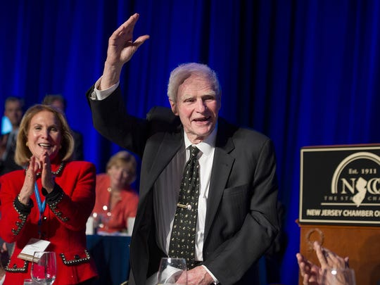 "FILE – In this April 22, 2014, file photo, former New Jersey Gov. Brendan Byrne waves as the audience sings him ""Happy Birthday"" and his wife Ruthi Zinn Byrne applauds, to mark his 90th birthday during the annual ""Congressional Dinner"" of the New Jersey State Chamber of Commerce in Washington, D.C. Byrne, a Democrat who served as New Jersey governor from 1974 to 1982, died Thursday, Jan. 4, 2018, at age 93."