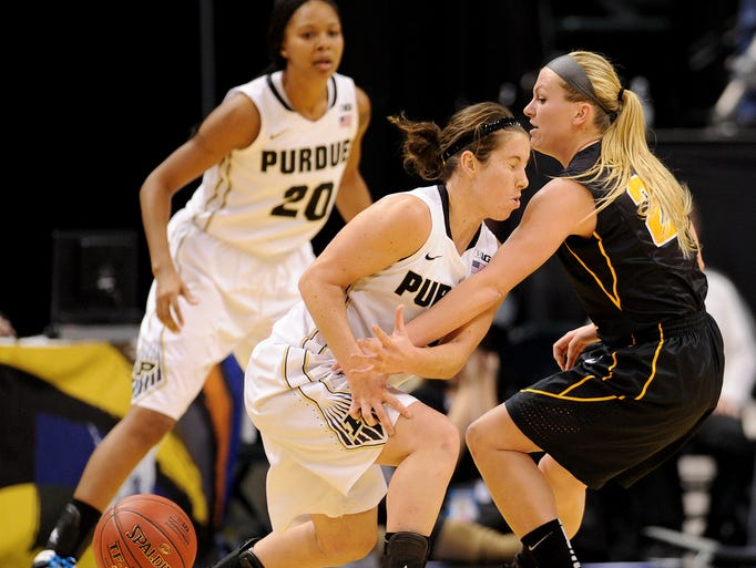 Purdue guard Courtney Moses has the ball knocked away by Iowa guard Melissa Dixon during the quarterfinals of the Big Ten Women's Basketball Tournament at Bankers Life Fieldhouse, Friday, March 7, 2014, in Indianapolis.