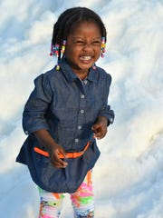 Dashney Jealjilles is having a great time in the snow. Thousands came for a winter frolic at Snowfest, held Saturday, Dec. 3 at Golden Gate Community Park.