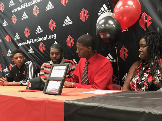 NFC senior Lyn Strange signed his letter of intent Thursday to play football at Louisville. Strange, a defensive back, graduated in December and will early enroll, starting classes at Louisville next week.