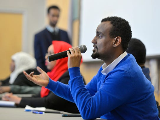 Somali community advocate Haji Yusuf answers a question