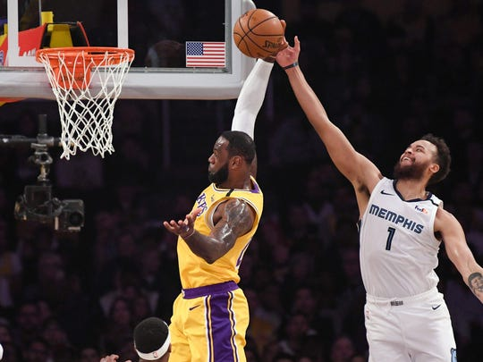 Feb 21, 2020; Los Angeles, California, USA;  Los Angeles Lakers forward LeBron James (23) tries to grab a rebound away from Memphis Grizzlies forward Kyle Anderson (1) during the second quarter at Staples Center. Mandatory Credit: Robert Hanashiro-USA TODAY Sports