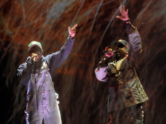 Andre 3000, left, and Big Boi of hip hop group Outkast perform behind a screen during their headlining set on the first day of the 2014 Coachella Music and Arts Festival on Friday, April 11, 2014, in Indio, Calif.