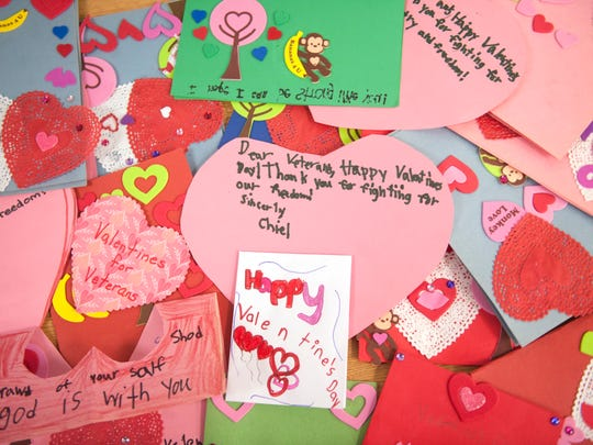 Kindergarten students at the the West End Memorial Elementary School in Woodbury make valentines that will be sent to veterans at the Philadelphia VA Medical Center.   Lynn Gorham, a kindergarten teacher at West End Memorial Elementary School, started the schoolwide valentines for veterans project over 20 years ago.