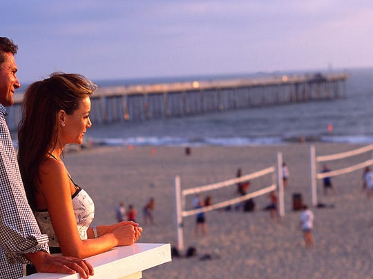 """Watch volleyball and waves from your """"beach cottage"""" balcony."""