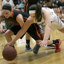 Xavier's Rachel Siciliano (left) looks to drive against West De Pere's Brehna Evans during a Bay Conference girls' basketball game Tuesday at Xavier. West De Pere stayed unbeaten in the league with a 56-44 victory. To see more photos, go to postcrescent.com.