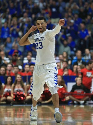 Kentucky's Jamal Murray fired off an arrow towards the bench after scoring a three-point shot late in the second half as the Wildcats clawed back to beat Georgia 93-80. Murray had 26 points with six rebounds.
