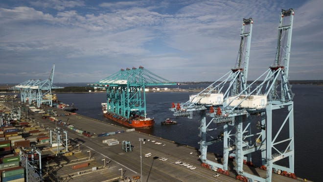 In this Jan. 7, 2019, file photo a Chinese ship carrying giant cranes approaches the pier at Virginia International GatewayTerminal in Portsmouth, Va.