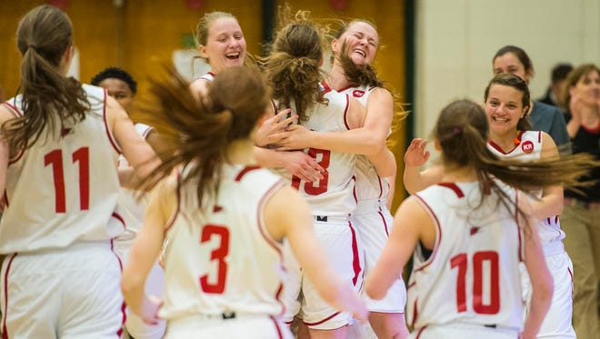 CVU players celebrate their victory over Rice during the D-1 girls semifinal at Patrick Gymnasium in Burlington on Thursday, March 5, 2015.