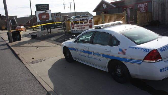 Police on the scene of a shooting Saturday, Nov. 23, 2013, at Pit and Barrel in Nashville, Tenn.