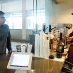 Jason Henderson converses with customer Enrique Pappalardo, left, while making him a drink Tuesday, May 26, 2015, at Redtail Cafe in Fort Collins, CO.