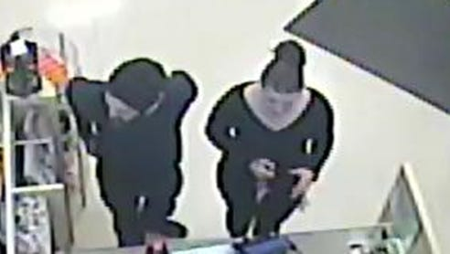 Two suspects using stolen credit card at a convenience store in Elkton, Md.